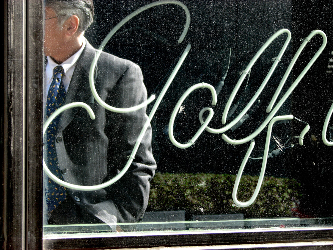 the refection of a salaryman in a golf accessory shop