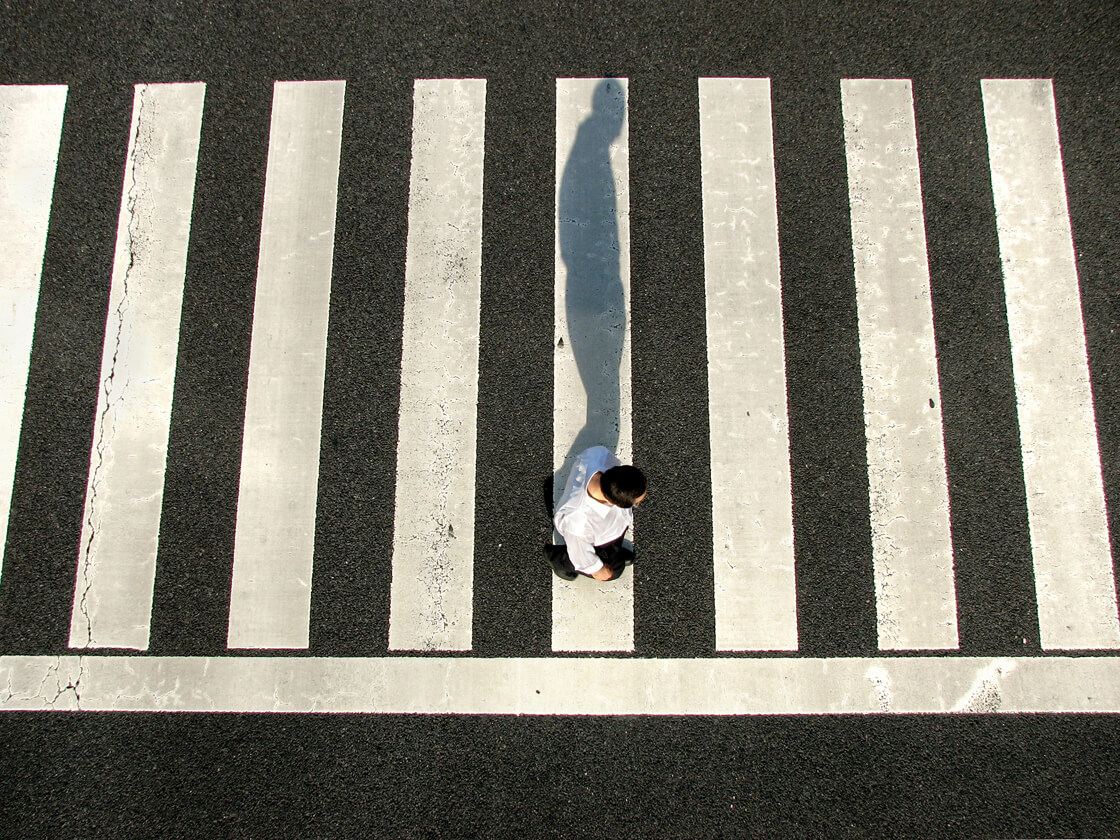 a salaryman on a pedestrian crossing in Suidobashi